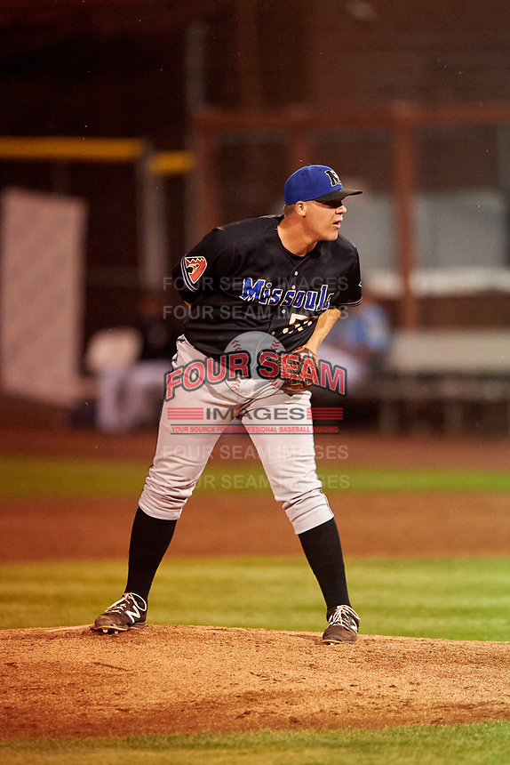 Missoula Osprey relief pitcher Landon Whitson (50) looks to his catcher for the sign during a Pioneer League game against the Idaho Falls Chukars at Melaleuca Field on August 20, 2019 in Idaho Falls, Idaho. Idaho Falls defeated Missoula 6-3. (Zachary Lucy/Four Seam Images)