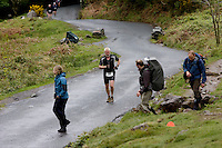 16 MAY 2009 - KESWICK,GBR - A competitor contends with the added obstacle of walkers as begins the climb to Walla Crag during the Keswick Mountain Festival Triathlon .(PHOTO (C) NIGEL FARROW)