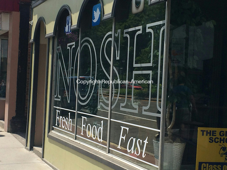 WINSTED, CT - 08 July 2015 - 070815CH7 -- Nosh cafe and bakery closed Wednesday after serving downtown for more than 10 years. Formerly Kelly's Kitchen, the restaurant is liquidating its equipment and decor. Carrie Grace Henderson Republican-American