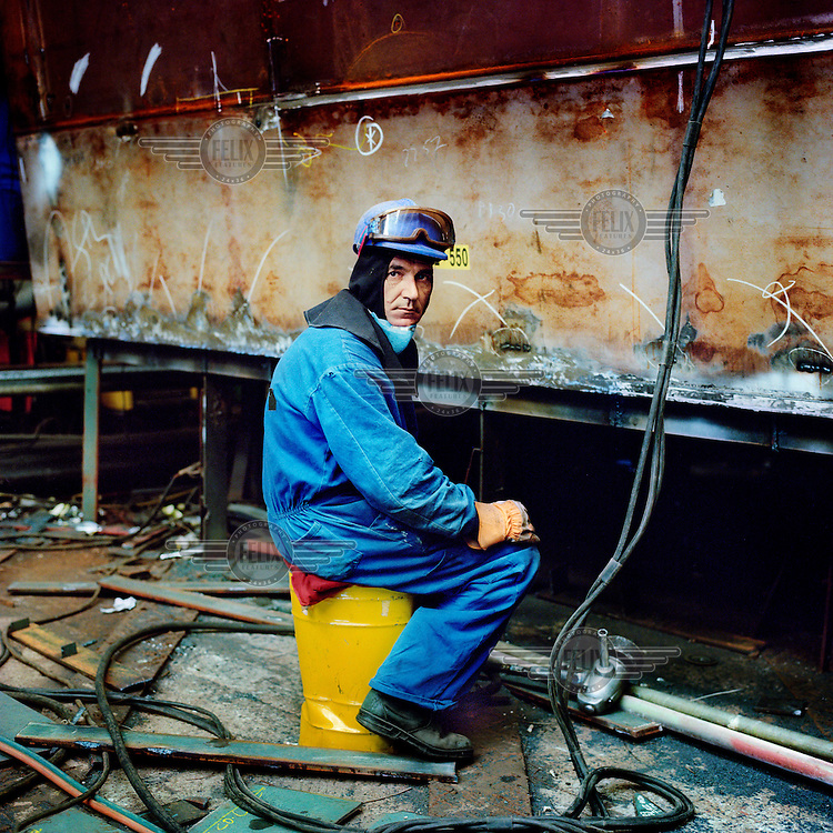 A welder works at the shipyards in Ferrol.