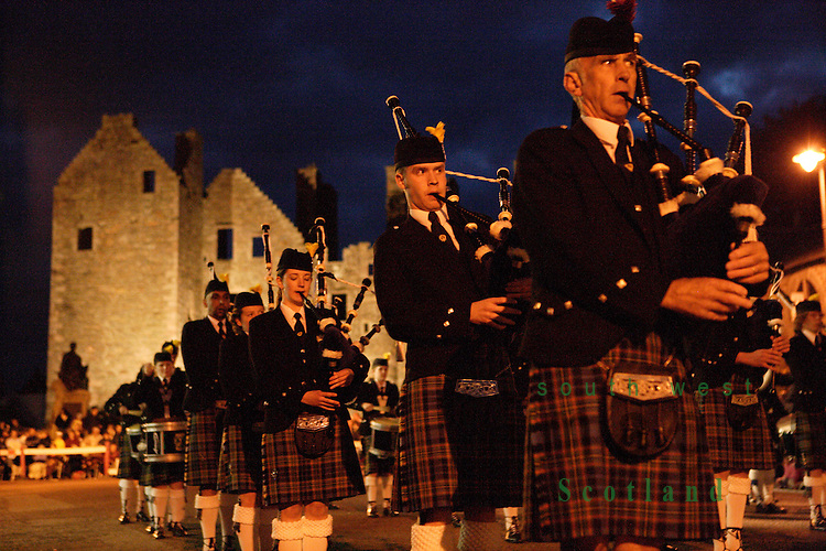 Kirkcudbright Tattoo Scotland UK Atmospheric dusk event piper bagpipes pipeband marching past MacLellans Castle