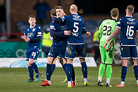 8th February 2020; Dens Park, Dundee, Scotland; Scottish Championship Football, Dundee versus Partick Thistle; Jordon Forster of Dundee hugs Josh Meekings at the end of the match