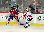 11 November 2008:  Montreal Canadiens' right wing forward Alexei Kovalev from Russia battles Ottawa Senators' defenseman Chris Phillips for puck possession in the second period at the Bell Centre in Montreal, Quebec, Canada. The Canadiens, celebrating their 100th season, defeated the visiting Senators 4-0. ***Editorial Sales Only***..Mandatory Photo Credit: Ed Wolfstein Photo *** Editorial Sales through Icon Sports Media *** www.iconsportsmedia.com