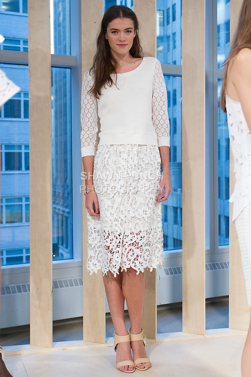 Model poses in an outfit from the Ann Taylor Spring Summer 2015 collection by Lisa Axelson on October 16, 2014.