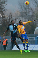 Wycombe Wanderers Marcus Bean wins an aerial challenge with Mansfield Town's Matt Green during the Sky Bet League 2 match between Mansfield Town and Wycombe Wanderers at the One Call Stadium, Mansfield, England on 31 October 2015. Photo by Garry Griffiths.