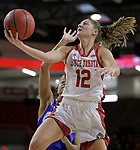 VERMILLION, SD: JANUARY 13:  Jaycee Bradley #12 of South Dakota dgets a layup past a Ft. Wayne defender during their Summit League game Saturday January 13 at the Sanford Coyote Sports Center in Vermillion, S.D.   (Photo by Dick Carlson/Inertia)