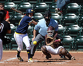 Michigan Wolverines Softball outfielder Lyndsay Doyle (11) at bat in front of umpire Rick Tumblestone and catcher Melissa Berouty during a game against the Bethune-Cookman on February 9, 2014 at the USF Softball Stadium in Tampa, Florida.  Michigan defeated Bethune-Cookman 12-1.  (Copyright Mike Janes Photography)
