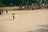 USA, Hawaii, surfer Sunny Garcia and crowd, Waimea Bay, Oahu