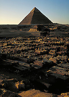 Coptic cemetery w  Giza Pyramids in background. Cairo Egypt, Giza Pyramids.
