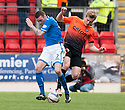 St Johnstone's James Dunne and Dundee Utd's Stuart Armstrong challenge for the ball.