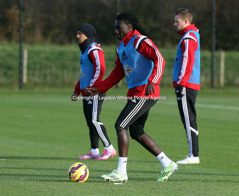 Pictured: Bafetimbi Gomis (C) Wednesday 10 December 2014<br /> Re: Swansea City FC training at Fairwood Training Ground, south Wales, UK