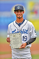 Asheville Tourists center fielder Manny Melendez (19) accepts his South Atlantic League Player of the Week Award before a game against the Rome Braves at McCormick Field on June 12, 2017 in Asheville, North Carolina. The Tourists defeated the Braves 7-0. (Tony Farlow/Four Seam Images)