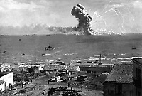 During the invasion of Sicily, an American cargo ship is hit by a bomb from a German plane and its cargo of munitions explodes, off Gela, Sicily, July 11, 1943.  Lt. Robert J. Longini.  (Army)<br /> NARA FILE #:  111-SC-180476<br /> WAR & CONFLICT BOOK #:  1023