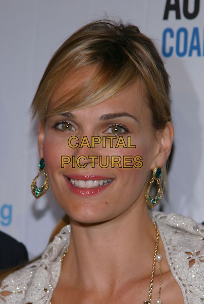 MOLLY SIMS.Endless Summer Party To Benefit The Autism Coalition and Surfers Healing held at the Esquire House. .September 30, 2004.Photo by V. Summers/AdMedia. .headshot, portrait, dangling earrings.www.capitalpictures.com.sales@capitalpictures.com.© Capital Pictures.