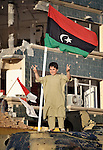 A boy poses on a tank captured by rebel forces in Misrata, the besieged Libyan city where civilians and rebel forces are surrounded on three sides by forces loyal to Libyan leader Moammar Gadhafi.