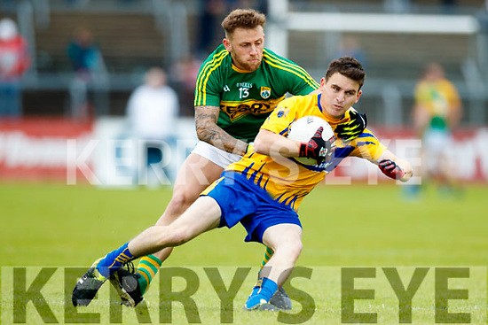 Barry John Keane Kerry in action against Martin McMahon Clare in the Munster Senior Football Championship Semi Final in Ennis on Sunday.
