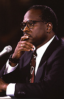 Washington DC. 9-10-1991 <br /> Clarence Thomas nominee for Associate Justice of the United States Supreme Court ponders questions to him from members of the Senate Judiciary Committee during his confirmation hearing.<br /> Credit: Mark Reinstein Credit: Mark Reinstein/MediaPunch