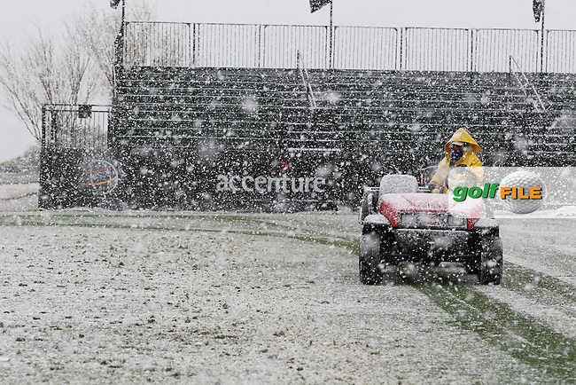 Green Keepers start to clear the Driving range when the sky opens and starts dumping more snow down at the WGC Accenture Match Play Championship 2013, Dove Mountain, Morana, Arizona..Picture: Fran Caffrey / www.golffile.ie ..
