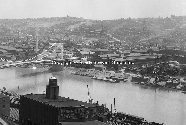 Pittsburgh PA:  View looking south towards the South Side and Monongahela River from the bluff at Duquesne University- 1932.  The view includes the construction of the 10th Street bridge which opened for traffic in 1933.