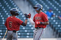 AZL D-backs Neyfy Castillo (17) is congratulated by Glenallen Hill Jr. (6) after hitting a home run during an Arizona League game against the AZL Cubs 1 on July 25, 2019 at Sloan Park in Mesa, Arizona. The AZL D-backs defeated the AZL Cubs 1 3-2. (Zachary Lucy/Four Seam Images)