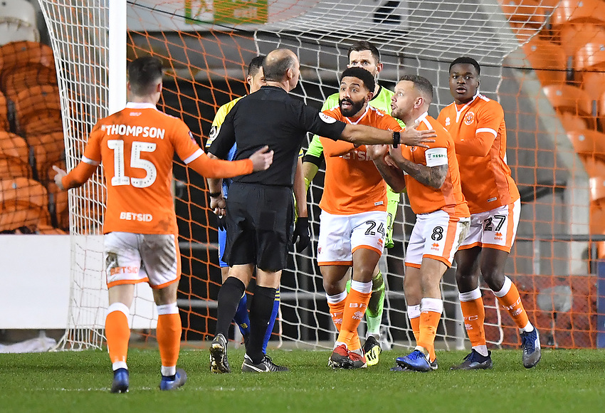 Blackpool players remonstrate with Referee Andy Haines after he awards Solihull Moors a penalty<br /> <br /> Photographer Dave Howarth/CameraSport<br /> <br /> The Emirates FA Cup Second Round Replay - Blackpool v Solihull Moors - Tuesday 18th December 2018 - Bloomfield Road - Blackpool<br />  <br /> World Copyright © 2018 CameraSport. All rights reserved. 43 Linden Ave. Countesthorpe. Leicester. England. LE8 5PG - Tel: +44 (0) 116 277 4147 - admin@camerasport.com - www.camerasport.com