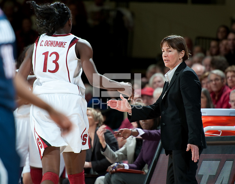 STANFORD CA-DECEMBER 30, 2010: Tara VanDerveer congratulates Chiney Ogwumike during the Stanford 71-59 victory over UCONN at Maples Pavilion.