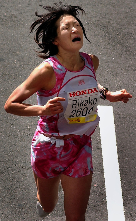 The pain of running over 26 miles shows on the face of this woman's runner as she crosses the finish line of the L.A. Marathon, Sunday morning in downtown Los Angeles.
