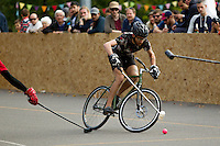 17 AUG 2014 - LONDON, GBR - A Triple Jay player swerves to avoid a challenge from a Mondial player during a game at the 2014 London Open bike polo tournament in Highbury Fields in London, Great Britain (PHOTO COPYRIGHT © 2014 NIGEL FARROW, ALL RIGHTS RESERVED)