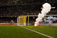 MELBOURNE, AUSTRALIA - JUNE 7: A flare is thrown onto the pitch during an international friendly match between the Qantas Australian Socceroos and Serbia at Etihad Stadium on June 7, 2011 in Melbourne, Australia. Photo by Sydney Low / AsteriskImages.com