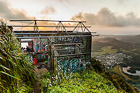 "Dawn light on an abandoned U.S. military building covered in graffiti near the top of Ha'iku Stairs (or ""Stairway to Heaven"") hiking trail in Kane'ohe, O'ahu."