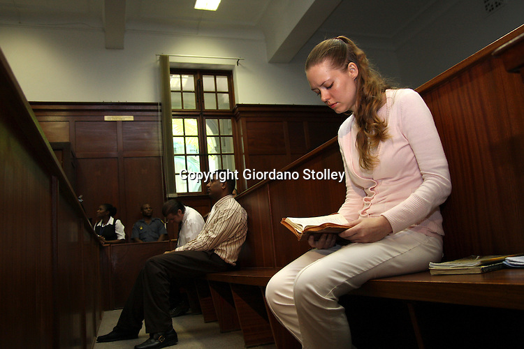 DURBAN - 13 March 2012 - Nicolette Lotter reads her bible in the dock of the Durban High Court on Tuesday, 13 March 2012 after being convicted along with her brother Hardus Lotter (far left) and Mathew Naidoo (C) of the murder of her parents..Picture: Giordano Stolley/ Allied Picture Press/ APP