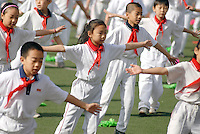 Children perform their morning exercise rituals at the first primary school attached to the XuanWu District normal school. XuanWu is located the south western part of the central city area, just outside the Imperial Inner City. In 2010, Xuanwu District was merged into Xicheng...