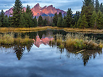 Grand Teton National Park, Wyoming:<br /> Sunrise light on the Teton range with beaver pond reflections at Schwabacher Landing