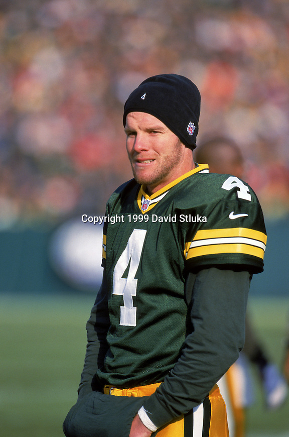 Green Bay Packers quarterback Brett Favre (4) looks on during an NFL football game against the Carolina Panthers at Lambeau Field on December 12, 1999 in Green Bay, Wisconsin.  The Panthers won 33-31. (Photo by David Stluka)