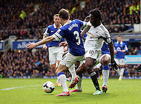 Pictured: Wilfried Bony of Swansea (R) is challenged by Leighton Baines of Everton (L). Saturday 22 March 2014<br /> Re: Barclay's Premier League, Everton v Swansea City FC at Goodison Park, Liverpool, UK.