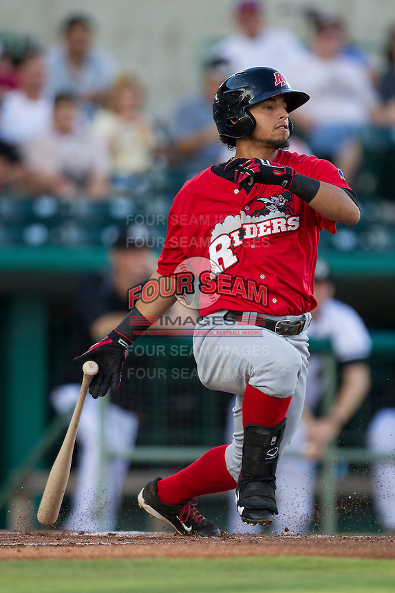 Frisco Roughriders second baseman Rougned Odor (10) follows through on his swing in the Texas League baseball game against the San Antonio Missions on August 22, 2013 at the Nelson Wolff Stadium in San Antonio, Texas. Frisco defeated San Antonio 2-1. (Andrew Woolley/Four Seam Images)