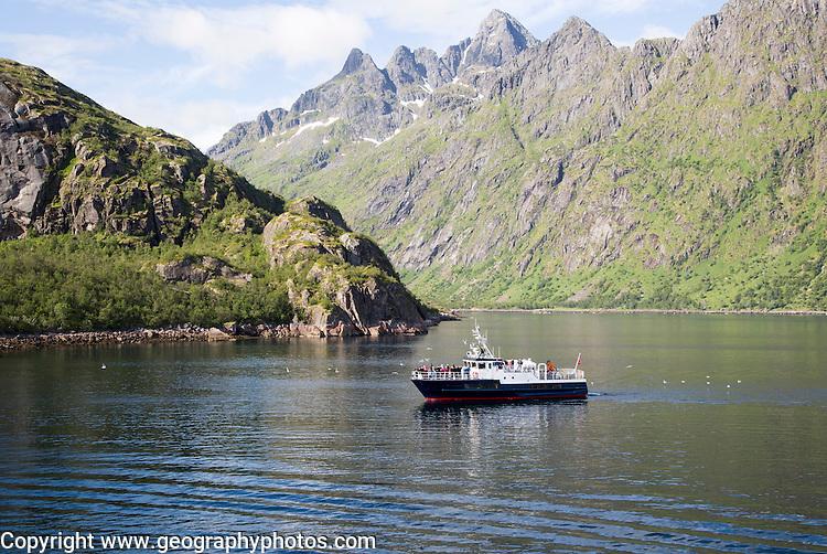 Jagged mountain peaks Raftsundet strait,  Lofoten Islands, northern Norway tour boat in Trollfjorden fiord
