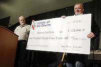 Thursday February 28, 2013  Dale Myers, (L) executor of the estate of the late Bill Devine, original artist of the Iditarod,  presents a $124,000 check to Iditarod Executive Director Stan Hooley to be used to perpetuate the Joe Redington Sr. trophy at the musher drawing banquet held at the Dena'ina Convention Center in Anchorage two days prior to the start of Iditarod 2013...Photo (C) Jeff Schultz/IditarodPhotos.com  Do not reproduce without permission.