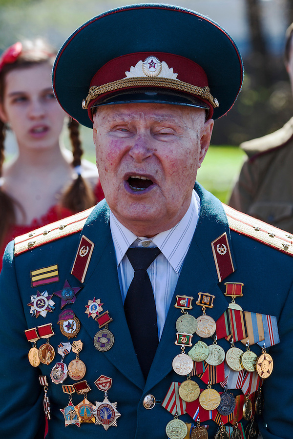 Moscow, Russia, 09/05/2013..A 90 year old Russian World War Two veteran sings a military song in Gorky Park during the country's annual Victory Day celebrations.