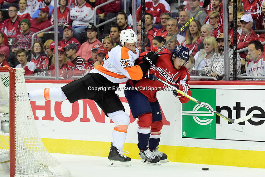 Friday, April 22, 2016: Philadelphia Flyers center Ryan White (25) checks Washington Capitals defenseman Nate Schmidt (88) during game 5 of the first round of the National Hockey League Eastern Conference playoffs  between the Philadelphia Flyers and the Washington Capitals held at the Verizon Center in Washington, DC. Eric Canha/CSM