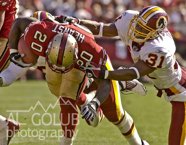 Washington Redskins defensive back David Terrell (31) tackles San Francisco 49ers running back Garrison Hearst (20) on Sunday, September 22, 2002, in San Francisco, California. The 49ers defeated the Redskins 20-10.