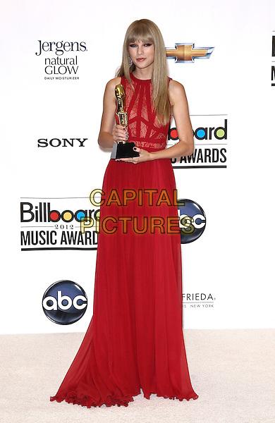 Taylor Swift.2012 Billboard Music Awards Press Room at the MGM Grand Garden Arena Las Vegas, Las Vegas, Nevada, USA..May 20th, 2012.full length red dress lace sleeveless award trophy.CAP/ADM/MJT.© MJT/AdMedia/Capital Pictures.