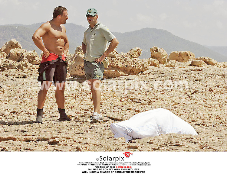 ALL-ROUND EXCLUSIVE PICTURES FROM SOLARPIX.COM.*MUST CREDIT SOLARPIX.COM OR DOUBLE FEE WILL BE CHARGED* .Basil Burke, nephew of Irish defence secretary Willie O Dey drowned as he leapt from a glass bottom boat with a friend in Ibiza and attempted to swim ashore. His friend survived..Pics show his body wrapped in a body bag and also the boat from which he jumped..REF: 2662 UHI.