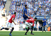 19th May 2018, Wembley Stadium, London, England; FA Cup Final football, Chelsea versus Manchester United; Olivier Giroud of Chelsea heads the ball forward over Chris Smalling of Manchester United