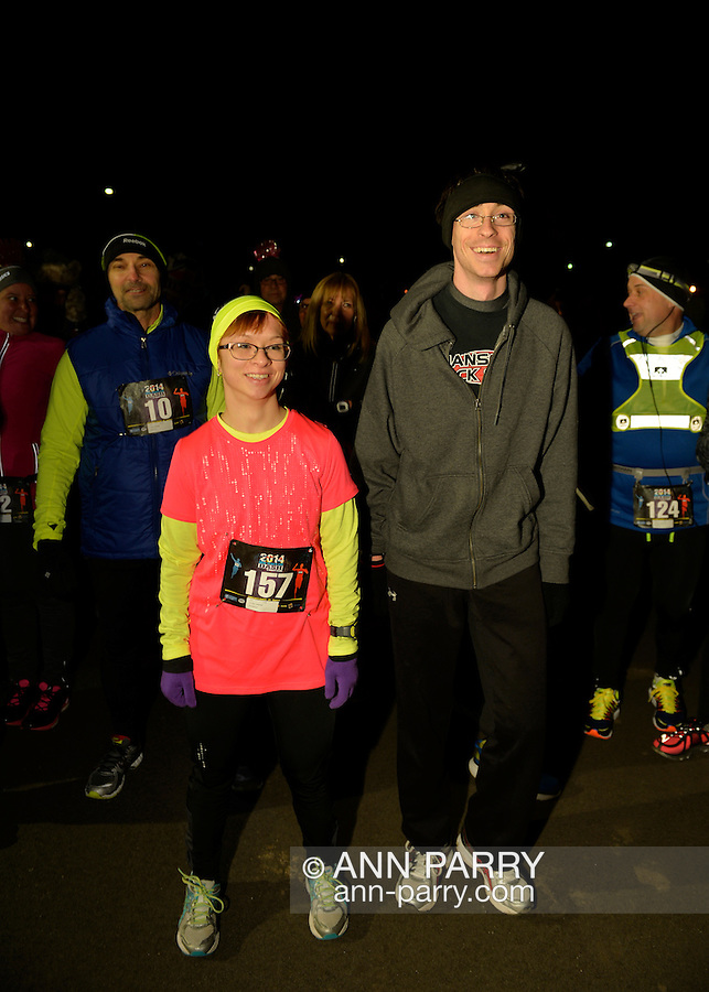East Meadow, New York, USA. December 31, 2014. ALYSSA PAGANO, of Ellenville, wearing bright pink and yellow, is one of the runners who will participate in a 5K New Year's Eve DASH to support the Long Island Council on Alcoholism and Drug Dependence (LICADD) at the Twin RInks Ice Center at Eisenhower Park in Long Island. A Skatin' New Year's Eve event started hours earlier and a New Year's Eve Party, open to runners, family and friends continued until 2:30 a.m.