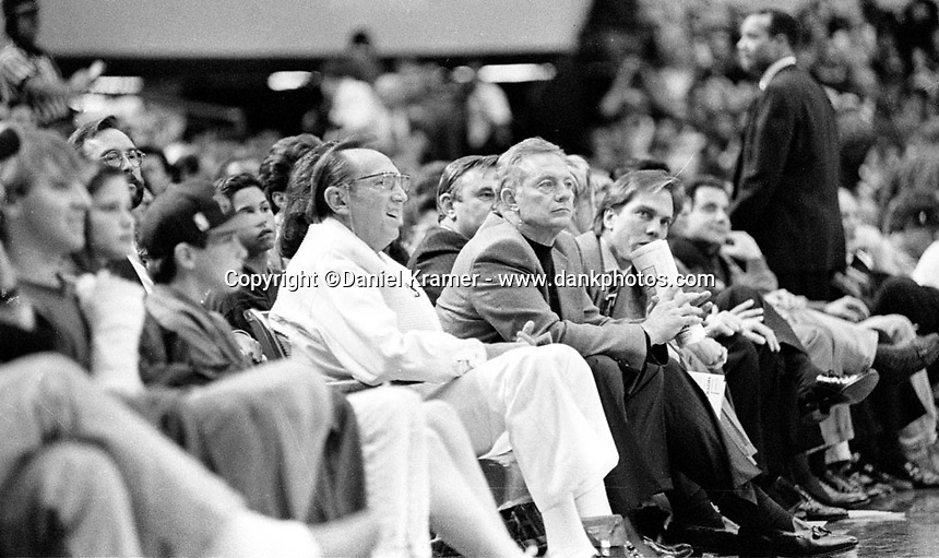Raiders owner Al Davis courtside with Dallas Cowboys owner Jerry Jones.