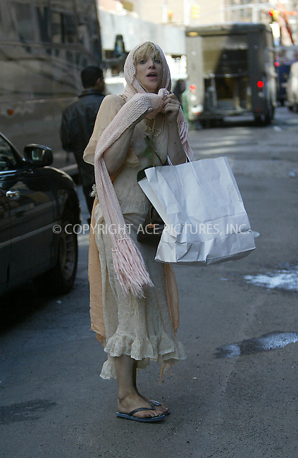 Courtney Love pictured arriving back to her Manhattain apartment. New York, March 22, 2004. Please byline: ACE Pictures.   ..*PAY-PER-USE*      ....IMPORTANT: Please note that our old trade name, NEW YORK PHOTO PRESS (NYPP), is replaced by our new name, ACE PICTURES. New York Photo Press and ACE Pictures are owned by All Celebrity Entertainment, Inc.......All Celebrity Entertainment, Inc:  ..contact: Alecsey Boldeskul (646) 267-6913 ..Philip Vaughan (646) 769-0430..e-mail: info@nyphotopress.com