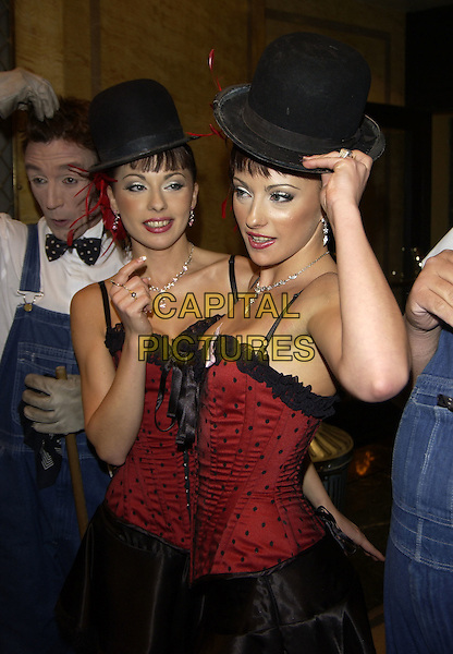 THE CHEEKY GIRLS.MONICA & GABRIELLA .10th anniversary Pink Anniversay Ball.Dorchester Hotel.London 09 October 2004.half length identical twins matching outfits red and black polka dot corset tops black skirt red shoes feathers in hair funny bowler hats.Ref: PL.www.capitalpictures.com.sales@capitalpictures.com.©Capital Pictures.