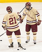 Steven Whitney (BC - 21), Johnny Gaudreau (BC - 13) - The Boston College Eagles defeated the visiting University of Vermont Catamounts to sweep their quarterfinal matchup on Saturday, March 16, 2013, at Kelley Rink in Conte Forum in Chestnut Hill, Massachusetts.