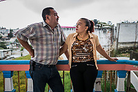 Carlos Saldana and Vicky Delgadillo stand on the balcony as they attend a birthday party for their grandson, Hector Yael, 10, at a family gathering at Vicky's daughter, Cinthia Hern&aacute;ndez Delgadilo's house in Xalapa, Mexico on November 4, 2017. <br /> Photo Daniel Berehulak for The New York Times